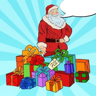 Pop-art-weihnachtsmann mit weihnachtsgeschenken auf weihnachtsverkauf.