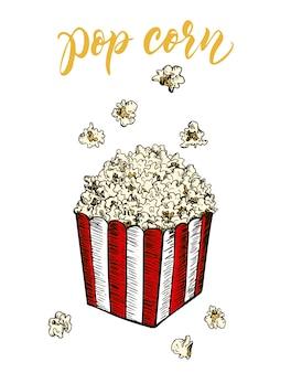 Popcorn in einem gestreiften karton