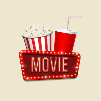 Popcornkorb rote cola-tasse und filmzeichen auf hellem hintergrundkino-bannerschablone