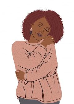 Porträt der netten afroamerikanischen frau, die sich umarmt. selbst glücklich und positiv, selbstbewusst lächelnd. liebe dich selbst und deinen körper positiv und lächle selbstbewusst. nehmen sie sich zeit für sich.