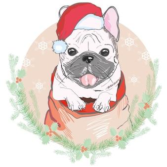 Porträt der netten französischen bulldogge im roten weihnachtshut. weihnachtsmann weihnachten.