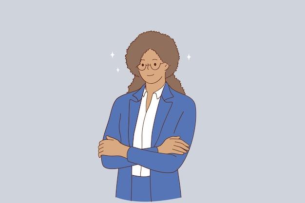 Porträt des lächelnden jungen geschäftsfrauenarbeiters im blauen anzug