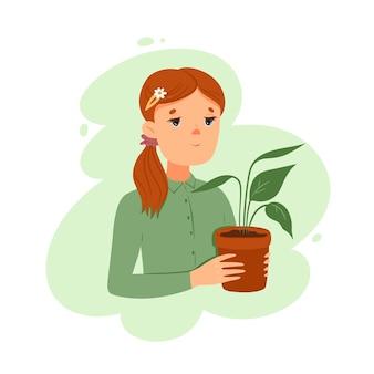 Porträt eines mädchens mit einer zimmerpflanze.