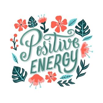 Positive energie schriftzug mit blumen