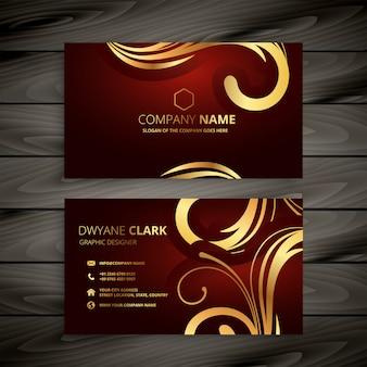 Premium-luxus-rote visitenkarte mit goldener dekoration