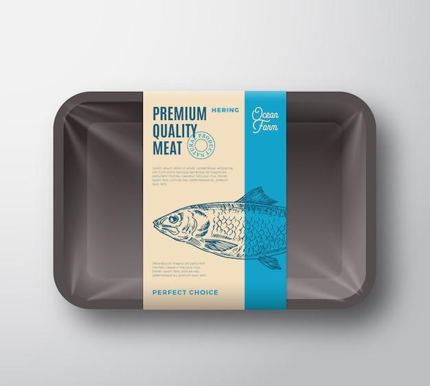 Premium qualität hering. abstrakte vektor-fisch-plastikschale mit zellophan-abdeckungsverpackungs-design-etikett.