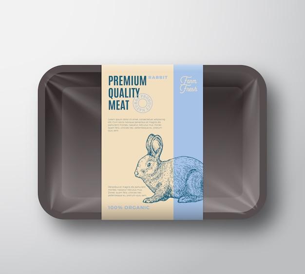 Premium quality rabbit pack. abstrakter fleischplastikbehälterbehälter mit zellophanabdeckung. verpackungsetikett. moderne typografie und handgezeichnetes kaninchen silhouette hintergrundlayout.