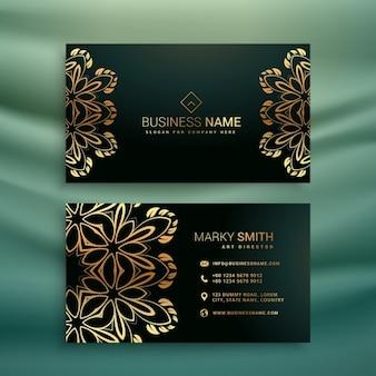Premium-visitenkarte mit goldenen floralen design
