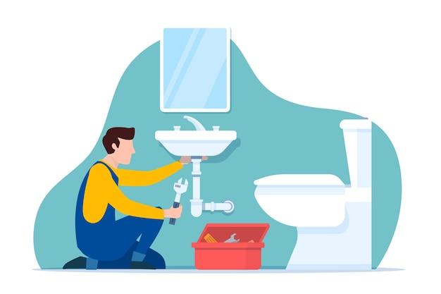 Professioneller arbeiter, der das badezimmer repariert