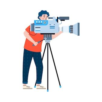Professioneller kameramann mit videokamera bei dreharbeiten zur filmkino-filmshow