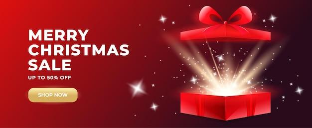 Promo-banner mit offener geschenkbox und goldglühendem konfetti mit überraschungsgeschenkbox