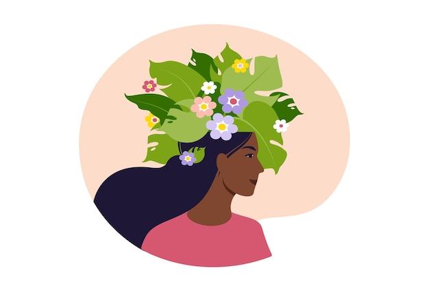Psychische gesundheit, glück, harmoniekonzept. glücklicher afrikanischer weiblicher kopf mit blumen nach innen. achtsamkeit, positives denken, selbstfürsorge-idee. vektor-illustration. eben.