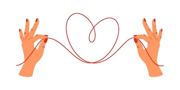 Psychologiekonzept menschliche hände, welche die enden von roten threads in form des herzens halten.