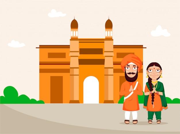 Punjabi-paar, das namaste mit gateway of india-denkmal auf pfirsich- und beigehintergrund für nationales festival von indien tut.
