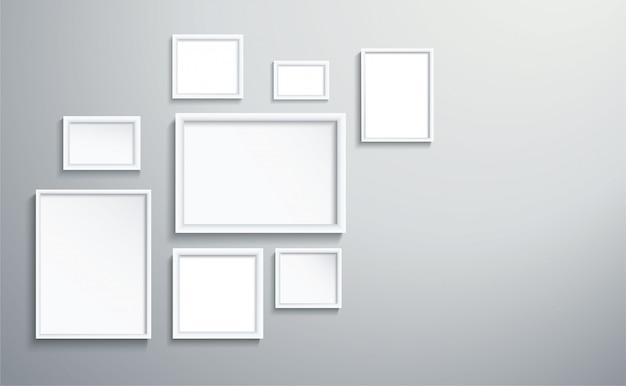 Quadratischer getrennter weißer bilderrahmen auf wand
