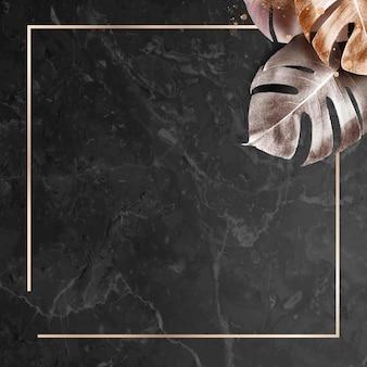 Quadratischer goldrahmen mit metallischem monstera-blatthintergrund