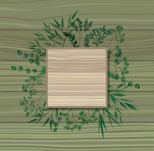 Quadratischer rahmen mit lorbeer blätter hölzernen hintergrund
