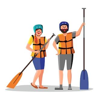 Rafting-leute tragen schwimmwesten-haltepaddel
