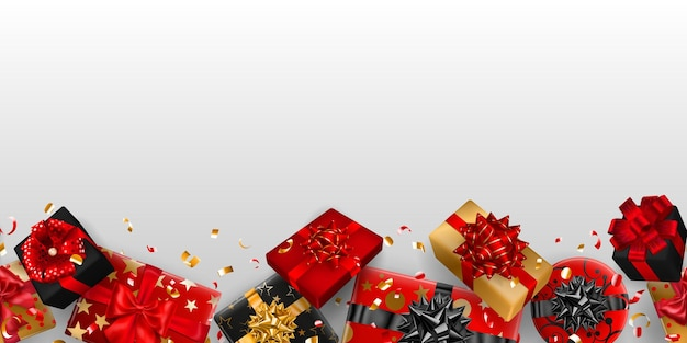 Rahmenhintergrund von roten, schwarzen und goldenen geschenkboxen mit bändern, schleifen und schatten und kleinen glänzenden serpentinenstücken auf weiß