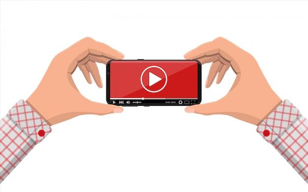 Rahmenloses smartphone mit videoplayer auf dem bildschirm.