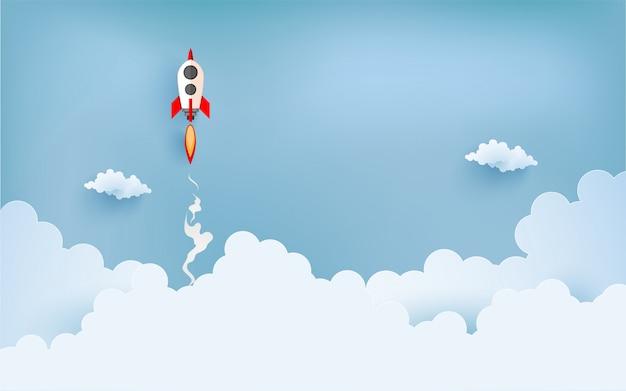 Raketenabbildung, die über wolke fliegt. papierkunst design