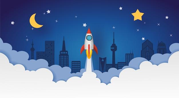 Raketenstart in den nachthimmel über der stadt mit mond und sternen. vektor-design in papierschnitt.