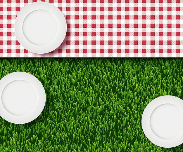 Realistische abbildung 3d der weißen leeren platte, rotes plaid des ginghams auf rasen des grünen grases