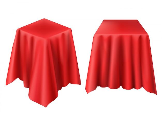 Realistische box mit rotem tuch bedeckt