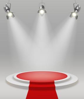 Realistische bühne mit scheinwerfern des roten teppichs in der mitte der raumvektorillustration