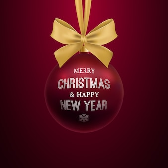 Realistische dunkelrote weihnachtskugel, die am goldenen bogen hängt.