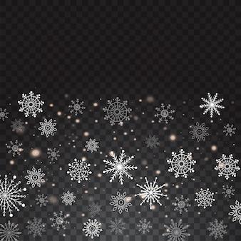 Realistische fallende schneeflocken lokalisiert auf transparentem hintergrund.