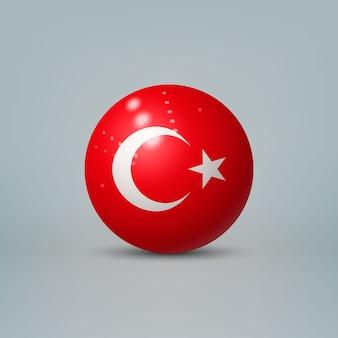 Realistische glänzende plastikkugel mit flagge der türkei