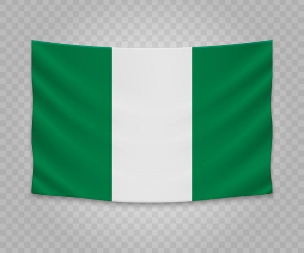 Realistische hängende flagge von nigeria