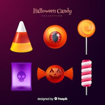 Realistische halloween-süßigkeitssammlung auf steigungshintergrund