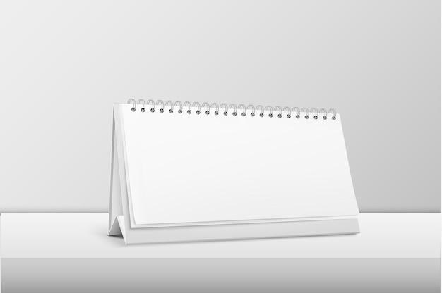 Realistische horizontale leere spiralkalender-nahaufnahme, die auf weißem tisch steht. designvorlage