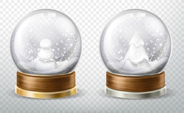 Realistische kristallkugel eingestellt mit gefallenem schnee