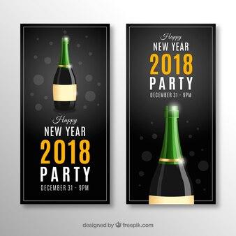 Realistische parteifahnen des neuen jahres 2018 mit champagner