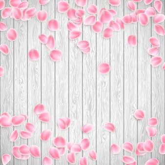 Realistische sakura-blütenblätter auf einem weißen hölzernen hintergrund, valentinstagschablone. und beinhaltet auch