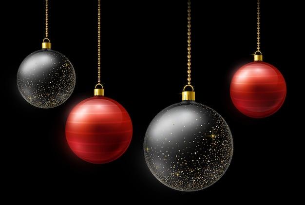 Realistische schwarze und rote weihnachtsbälle, die an den goldperlenketten auf dunklem hintergrund hängen