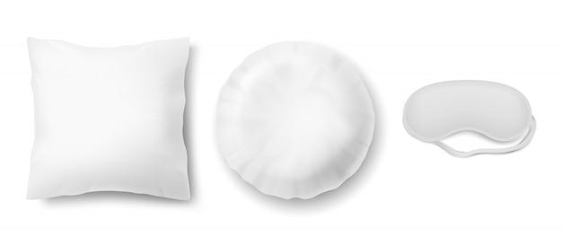 Realistische set mit augenbinde und zwei saubere weiße kissen, quadratisch und rund