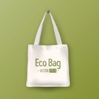 Realistische vektorweiße leere textileinkaufstasche. nahaufnahme auf grünem hintergrund. designvorlage für branding, mockup. eps10-abbildung.