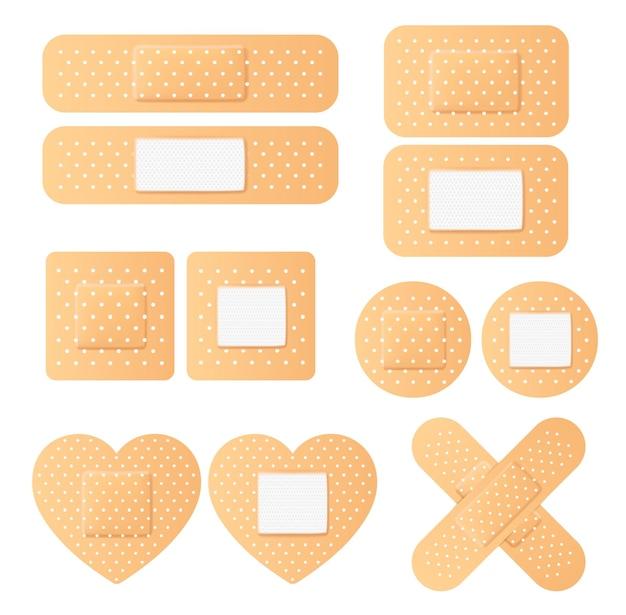 Realistischer antibakterieller gips für verletzungen und kratzer in verschiedenen formen und formen eingestellt