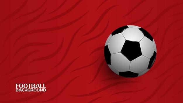 Realistischer fußball auf rotem hintergrund