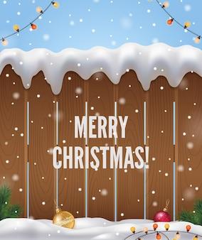 Realistischer hintergrund der frohen weihnachten mit weihnachtsbaumzaun und schnee