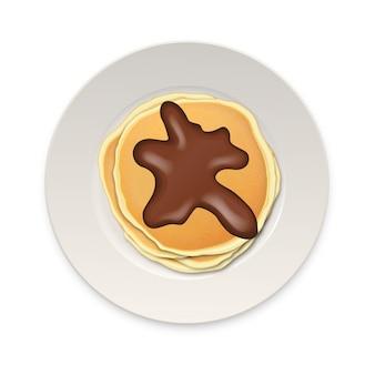Realistischer pfannkuchen mit schokolade auf einer weißen plattennahaufnahme lokalisiert auf weißem hintergrund, draufsicht.