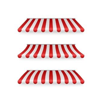 Realistischer satz gestreifter roter und weißer markisen. zelte oder textildächer für den einzelhandel. illustration lokalisiert auf weißem hintergrund