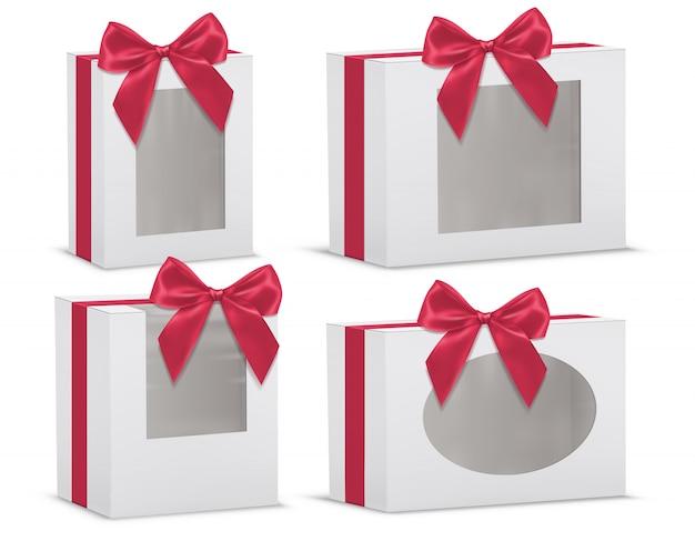 Realistischer satz leere geschenkboxen mit roten seidenbögen und mit den transparenten fenstern lokalisiert