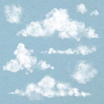 Realistischer wolkenelementvektor in blauem hintergrund eingestellt
