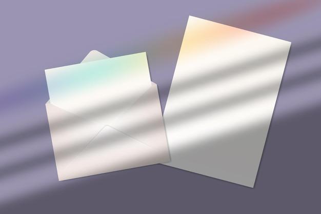 Realistisches leeres papierblatt und brief im umschlag mit schatten