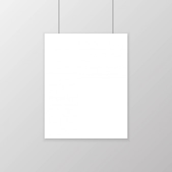 Realistisches leeres weißbuchplakat, das an der wand hängt